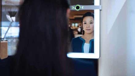 Women uses iris recognition at airport