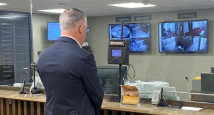 man at iris recognition terminal